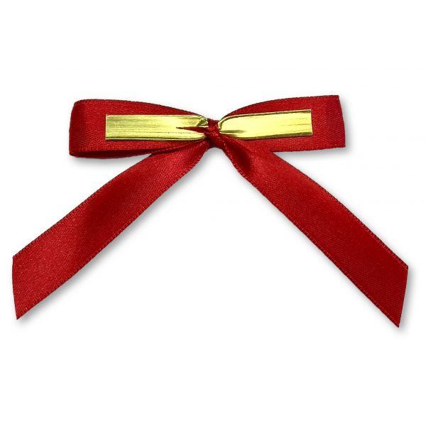 Rote Schleife mit goldfarbenem Clip